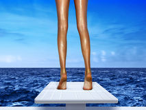 Legs on springboard Royalty Free Stock Photography