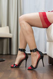 Legs with stockings, garter belt and high heels shoes Royalty Free Stock Image