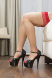 Legs with stockings, garter belt and high heels shoes Royalty Free Stock Photo