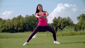 Legs stretching exercise. Fitness woman stretching legs before training stock video footage