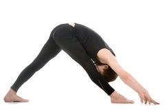 Legs stretching exercises, yoga pose parshvottanasana Royalty Free Stock Photo