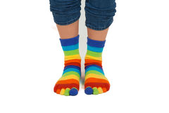 Legs in striped socks. Female legs in colorful striped socks Stock Photo