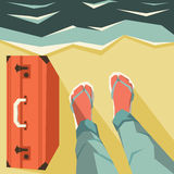 Legs and suitcase on beach Royalty Free Stock Images