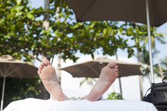 Legs of the sunbathing person Royalty Free Stock Image