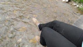 Legs Swinging on the Bridge stock video