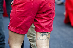 Legs with tattoos Royalty Free Stock Images