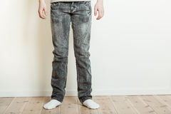 Legs of teenager standing on floor Royalty Free Stock Photos