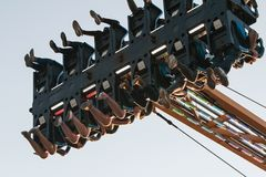 Legs Of Teenagers Dangle In Midair On County Fair Ride Stock Photos