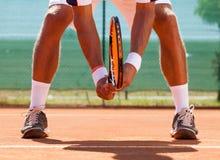 Legs of tennis player. Tennis player  waiting tennis ball Royalty Free Stock Photos