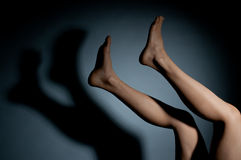 Legs and their shadow Stock Image