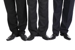 Legs of three businessmen Royalty Free Stock Image