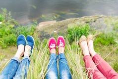 Legs of three girls. Stock Photo