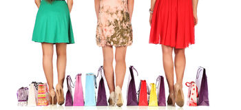 Legs of three glamorous girlfriends with paperbags Stock Photography