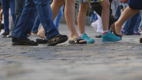 Legs of tourists on Red Square in Moscow stock footage