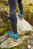 Legs of trail runner climbing Royalty Free Stock Images