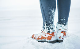 Legs of traveler in snow outdoor. Travel and discovery concept Stock Photography