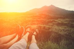Legs of travelers at sunset near mountain royalty free stock photos