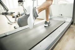 Legs on treadmill Stock Photos
