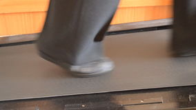 Legs On A Treadmill. This is footage of a businesswoman taking a sport rest to do some cardio on a treadmill stock footage