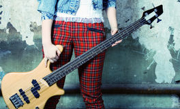 Legs in trousers and a guitar Royalty Free Stock Photos