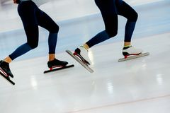 Legs two athletes speed skaters Stock Photo