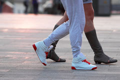 Legs of two people walking. The legs of two people walking Stock Photography