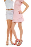 Legs of two stylish girls Stock Images