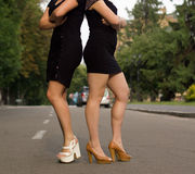 Legs of two women Stock Image