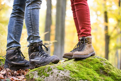 Legs of unrecognizable man and woman in autumn nature Royalty Free Stock Photo
