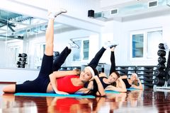 Legs up. Group of young women in the gym centre Stock Images