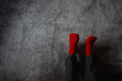Legs up the wall, putting feet up. Man wearing red socks in relaxing yoga pose with his legs on the wall Royalty Free Stock Images