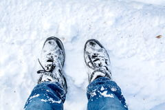Legs. Walk in the snow in winter royalty free stock photos