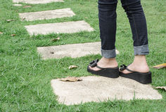 Legs walking on garden Royalty Free Stock Photography