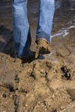 Legs walking through mud. Royalty Free Stock Photos