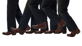 Legs Walking One Step Forward. Boots advancing symbolize progress and accomplishment stock image