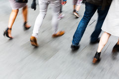 Legs of walking people with motion blur Stock Photos
