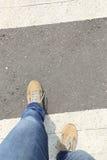 Legs walking on zebra crossing road Stock Photo