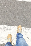 legs walking on zebra crossing road Royalty Free Stock Photography