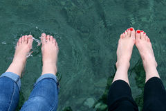 Legs in the water making splashes Stock Photo