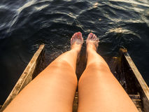 Legs in water. Stock Photo