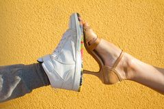Legs wearing ballroom and hip hop dancing shoes royalty free stock photos