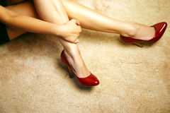 Legs wearing heels Stock Photo