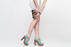 Legs wearing high heels and hand bag Royalty Free Stock Photography