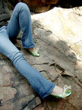 Legs wearing jeans Royalty Free Stock Photography