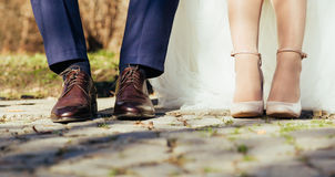 Legs Of Wedding Couple Royalty Free Stock Photography