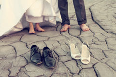 Legs of wedding couple in dirty shoes Stock Images