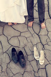 Legs of wedding couple in dirty shoes Royalty Free Stock Photography