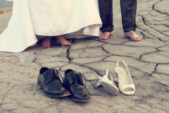 Legs of wedding couple in dirty shoes Stock Photos