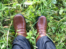 Legs in wet boots Stock Images
