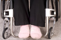 Legs in a wheelchair Stock Photos